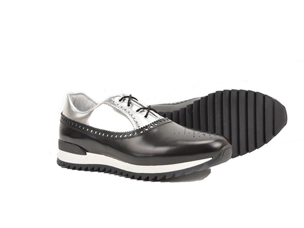 low top running in black and silver shiny leather